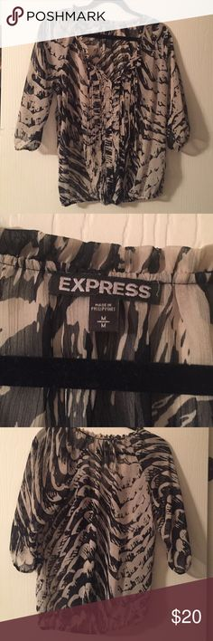 Express blouse Express blouse.  Tan and black color Express Tops Blouses