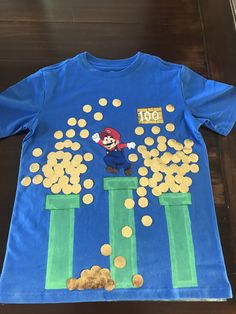 day of school mario shirt painted with acrylic paint Gold coins made with dance fabric and adhered with liquid stitch 100 Days Of School Project Kindergartens, 100 Day Of School Project, School Projects, School Times, School Days, 100days Of School Shirt, 100s Day, Back To School Kids, Kindergarten Class