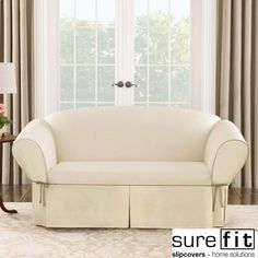 This cream loveseat slipcover from Sure Fit is an easy way to update the look of your older furniture. The cotton-and-polyester blend provides a crisp and comfortable fabric, and the contrast cord-duck pattern matches most popular design styles.