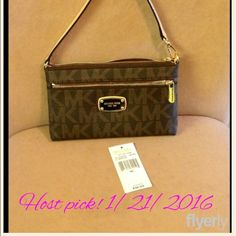 """Michael Kors large wristlet Michael Kors Jet Set large wristlet. Brown with MK logo. The handle adjusts there is a zip pocket on the outside. Zip top closure with slip pocket on one side and 4 card slots in other. Dimensions are approximately 8""""x5""""x11"""". Comes with gift box and care card. Michael Kors Bags Clutches & Wristlets"""