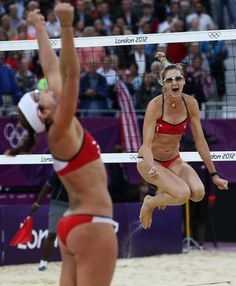 United States' Misty May-Treanor, left, and Kerri Walsh Jennings celebrate after defeating China in their semifinal women's beach volleyball match.