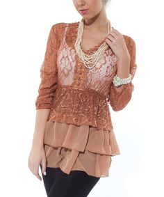 Create a fabulously feminine ensemble by slipping on this trendy tunic. A beautiful blend of lace and ruffles, it frames the figure in sweet romance.   Measurements (size M): 31'' long from high point of shoulder to hem95% nylon / 5% spandexHand washImported