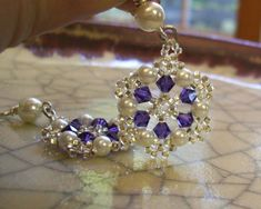 Beaded dangles, handmade.    I used tanzanite swarovski crystal, snow white glass pearls, and tiny silver lined glass beads and wove them by hand