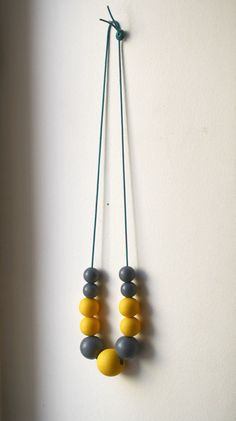Gray and yellow wooden bead necklace.