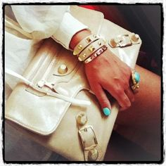The purse, wrist-candy and nail color. All me!