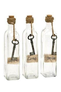 Adorned with burlap labels and antiqued key embellishments, the set of three Magdaline inspirational glass bottles add a vintage feel to any room. Accent your home with these elegant glass bottles. Wine Bottle Crafts, Jar Crafts, Bottle Art, Beer Bottle, Twine Crafts, Vodka Bottle, Bottles And Jars, Glass Bottles, Mason Jars