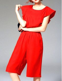 Red vintage look shorts jumpsuit with ruffled sleeves perfect for your engagement photo shoot, a wedding, party, or night out. Great women's #fashion item to dress up in #style.