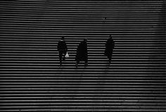 Men in black on lines