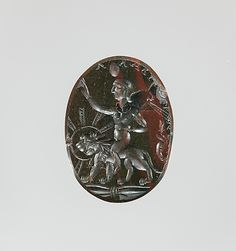 Jasper intaglio: Harpocrates riding a lion. Period: Imperial Date: ca. 2nd–3rd century A.D. Culture: Roman Medium: Jasper, red and green Dimensions: Other: 5/16 in. (0.8 cm) Classification: Gems Credit Line: Gift of John Taylor Johnston, 1881 Accession Number: 81.6.294
