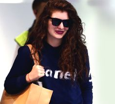 Shop the coolest logo sweatshirts inspired by Lorde's Chanel one