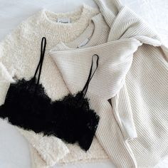 Cozy sweaters and a little black bralette.