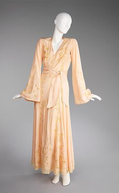 Circa 1935 French Negligée. Made of the finest silk, the work entailed in applying the lace to the slippery silk and carefully cutting it away would have been labor-intensive and therefore extremely costly.