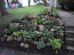 Garden and Patio, Backyard Landscaping Ideas For Small Yards With Various Herb Plants, Sloping Garden And Rocks Beside Concrete Pathway And Green Grass Ideas ~ Backyard Landscaping