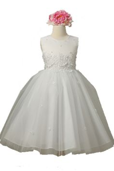 Sleeveless high scoop neckline dress with three button back and ties at the waist. Dress has a beaded top, flower detailing on the bodice, and flowers on the tulle overlay skirt. Made