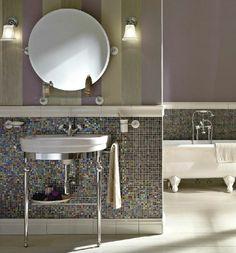 We love the #Sbordoni #mosaic and striped-wall bathroom.