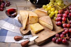 Cheese and red wine grapes