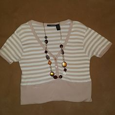 Great Top! Just Haven't worn! Extra Editions top with white and  tan/brown strips.  Top has a v-neck design with three buttons, and a thick tan/brown band at the bottom. Dress it up with a nice accent piece or wear it by itself. (Necklace not included ). Extra Editions  Tops Crop Tops