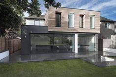 old house extension with glass addition in contemporary style