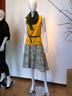 Lemon reversible silk tank, printed sueded silk flare skirt. Peacock chiffon scarf.