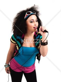 view of a young female singer with microphone. - View of a young female singer with microphone against white background. Model: Taylor Chmiel