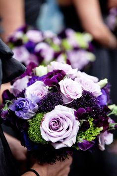 Gorgeous Beautiful bridal bouquet with purple roses wedding flowers for the bride on her wedding day