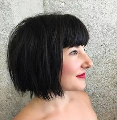 Choppy, black, chin length bob with bangs