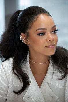 If you've got thick hair, maximize it's potential and keep it out of your face with a look a la Rihanna. Spritz in a texturizing spray when you blow-dry, then pull hair up into a high ponytail.     - Redbook.com