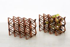 The Paradigm Wine Rack uses a repetitive principle, replicating the form vertically as well as horizontally forming a unique structure that has been designed dimensionally to house wine bottles. The uniqueness comes from the fact that bottles can be placed in several ways, creating interesting visual essays. #RBY #contemporaryfurniture #paradigm #winerack