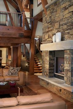 #stone fireplace http://adoreyourplace.com/2012/11/13/lodge-love/