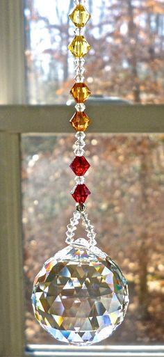 Swarovski Crystal Ball on Chakra Colored Strand Crystal Sun