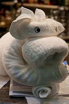 Another cute animal towel origami design. Eyes are added on the head to convey the feeling and emotion the towel design conveys. Origami Design, Origami Towel Folding, Napkin Folding, Elephant Towel, Decorative Hand Towels, Towel Animals, How To Fold Towels, Towel Crafts, Diy Crafts