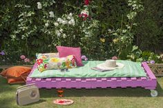 Here's an upcycling idea - transform old pallets into perfect picnic seats by adding wheels, cushions and colour. Cuprinol Garden Shades: Purple Pansy