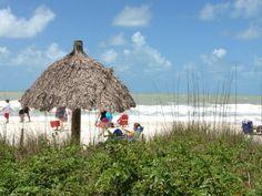 public tiki hut beach in Naples, FL