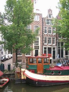 So beautiful! Especially when I visited in the Fall! boats docked on the canal in Amsterdam,