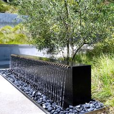 Water Studio designs and builds contemporary water feature, water walls, and fire features for commercial, residential, and public spaces Water Wall Fountain, Garden Water Fountains, Terrace Garden Design, Pool Landscape Design, Backyard Water Feature, Ponds Backyard, Water Features In The Garden, Outdoor Water Features, Contemporary Water Feature