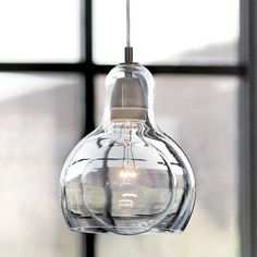 Mouth-Blown Glass Modern Mini Pendant Light around $59, comes in amber and honey also