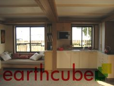 The integrated Day Bed doubles as Couch and Single Guest Bed, The Cabinetry is in Bamboo and Cinnamon Woods.    See the whole story at... earthcube.co.nz/