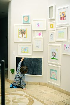 a kids art wall with chalkboard/whiteboard for ever changing art