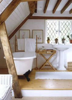 Exposed wood beams + claw foot tub.