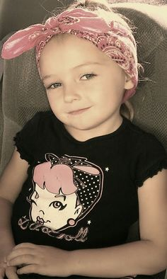 My baby girl:) Time to make her sit long enough to rock the Victory rolls!