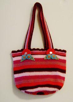 Pink crochet bag.
