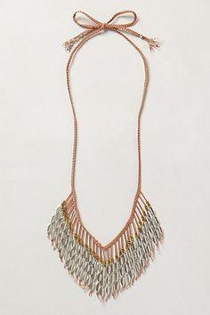 // cowrie fringe necklace