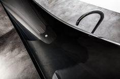 Vessel by Splinter Works. Hanging carbon fiber bathtub.