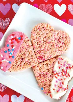 Dipped in chocolate, colored in pink, and sprinkled with candies, these yummy Valentine's Day Rice Krispies Treats are oh-so fun to make and decorate with your kids.