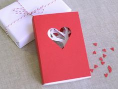 Heart box with Artsy Tree Cut-Out Insert  ~I made this for Jay (my husband) for Valentine's Day this year and he was super impressed!  HE's the artsy one in our house!  I didn't have enough red cardstock in the house for the outer box so I used photo paper and painted it crimson red... had a striking effect!