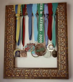 Wrap medals around a picture frame. Good for one's that belong together?