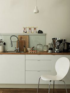 Kitchen Inspiration -White Cabinets -Modern Stainless Steel Hardware -Wood/Butcher Block Counter Tops (Option to do Grey Stone) -Industrial Modern Faucet