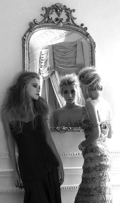 mary kate and ashley olsen- I love the beauty of this photo. Hair, makeup, outfits and the way she is looking in the mirror.