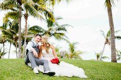 ©Nadi Bay Photography. Newly weds sitting in the Sofitel Fiji gardens enjoying the moment.