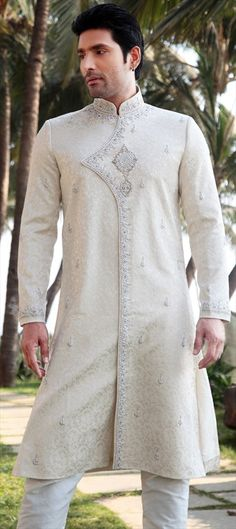 11193 White and Off White color family Sherwani in Brocade fabric with work. White Suits, Blue Suits, Mens Fashion Suits, Mens Suits, Mens Ethnic Wear, Wedding Wear, Wedding Outfits, Off White Color, Sherwani
